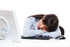Businesswoman sleeping on her workplace Royalty Free Stock Image