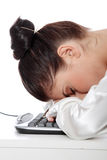 Businesswoman sleeping on the keyboard Royalty Free Stock Image