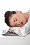 Businesswoman sleeping on the keyboard Royalty Free Stock Photography