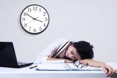 Businesswoman sleeping with laptop Stock Image
