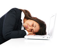 Businesswoman sleeping on laptop during work Royalty Free Stock Image
