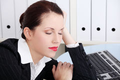 Businesswoman sleeping in the office. Beautiful caucasian businesswoman sleeping in the office Stock Photos