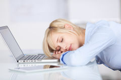 Businesswoman Sleeping At Office Desk Stock Photos