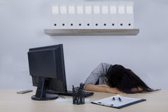 Businesswoman sleeping in the office room Stock Photography