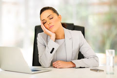Businesswoman sleeping office Stock Image
