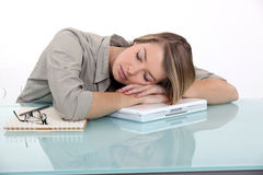 Businesswoman sleeping at work Royalty Free Stock Image