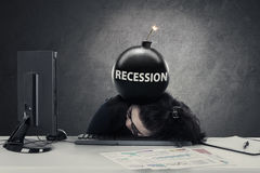 Businesswoman sleeps with bomb recession Stock Photos