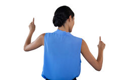 Businesswoman in sleeveless clothing pointing on interface. Against white background Royalty Free Stock Photography