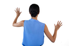 Businesswoman in sleeveless clothing touching interface. Against white background Royalty Free Stock Images