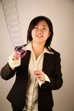 Businesswoman with a slinky Royalty Free Stock Image