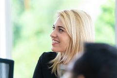 Smile businesswoman smart female blond caucasian. Businesswoman smart female blond caucasian close up head smiling stock image
