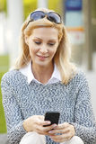 Businesswoman with smart phone Stock Photos