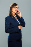 Businesswoman with smart phone Royalty Free Stock Image
