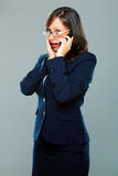 Businesswoman with smart phone Royalty Free Stock Photography