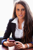 Businesswoman with a smartphone Royalty Free Stock Photography