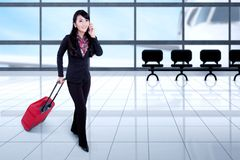 Businesswoman with smartphone in the airport Royalty Free Stock Photo
