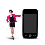 Businesswoman and smartphone - isolated Stock Photography