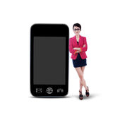 Businesswoman and smartphone - isolated Stock Photos