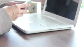 Businesswoman With Smartphone And Laptop In The Office. stock video