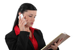 Businesswoman with a smartphone Stock Photography