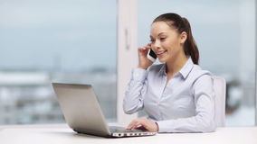 Businesswoman with smartphone in office stock footage