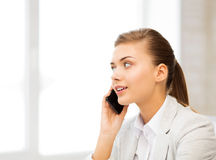 Businesswoman with smartphone in office Royalty Free Stock Image