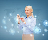 Businesswoman with smartphone over blue background Stock Photos