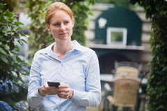 Businesswoman with a Smartphone Royalty Free Stock Images
