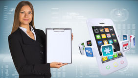 Businesswoman with smartphones and colorful apps Royalty Free Stock Images