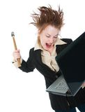Businesswoman smashing laptop with a hammer Royalty Free Stock Image