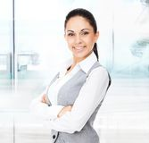 Businesswoman smile, folded hands in modern office Stock Image