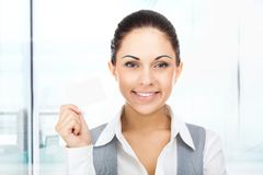 Businesswoman smile hold blank business card Stock Image