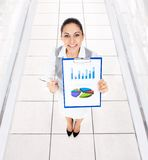Businesswoman smile hold clipboard report document royalty free stock photo