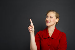 Businesswoman smile point finger to empty copy space, business w Stock Photography