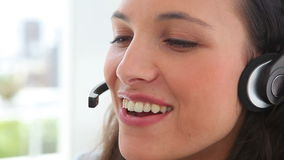 Businesswoman smiles as she talks on a headset Stock Images