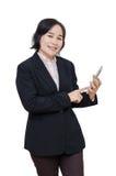 Businesswoman smiles over white background Stock Photos