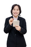 Businesswoman smiles over white background Stock Image