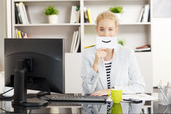Businesswoman with smiley face sign Stock Photo