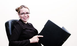 Businesswoman smiling. Businesswoman holding a folder Royalty Free Stock Photography