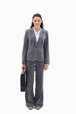 Businesswoman smiling with briefcase Royalty Free Stock Images