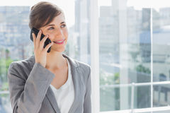 Businesswoman smiling and calling on phone Stock Photography