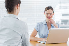 Businesswoman smiling at camera during an interview Royalty Free Stock Photos