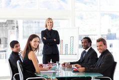 Businesswoman smiling at the camera in a meeting Royalty Free Stock Photo
