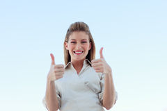Businesswoman smiling at the camera with thumbs up Royalty Free Stock Image