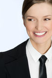 Businesswoman smiling - close portrait of woman. Closeup, nice face, ideal customer service and worker Stock Photo