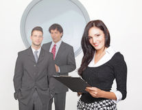 Businesswoman smiling with colleague in the backgr Royalty Free Stock Photography