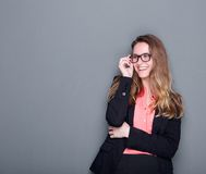 Businesswoman smiling with glasses Royalty Free Stock Photos