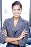Businesswoman smiling with her arms folded, portrait Royalty Free Stock Images