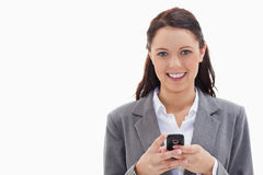 Businesswoman smiling and holding her mobile Royalty Free Stock Photos