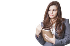 Businesswoman smiling holding note book Royalty Free Stock Images